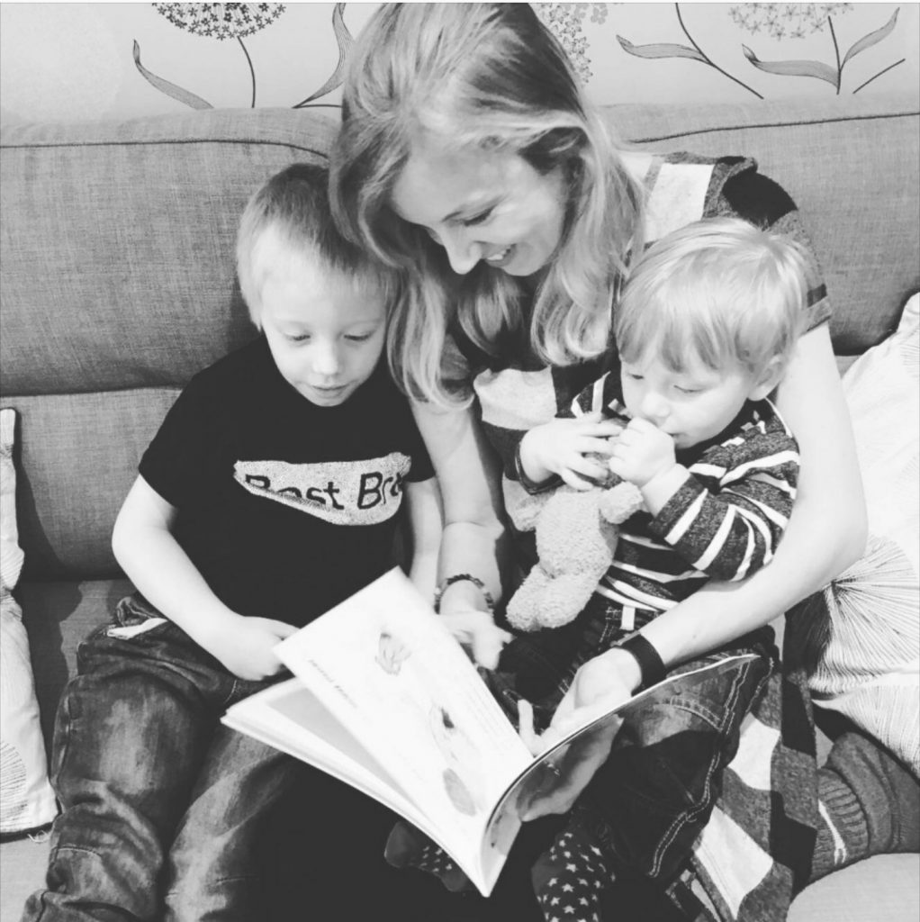 Author Hayley Mitchell reading a Charlie Bear book to her boys