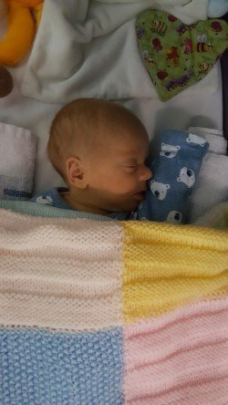 My little boy tucked up in his hospital cot for the night