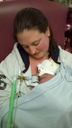 Me cuddling my little premature baby boy