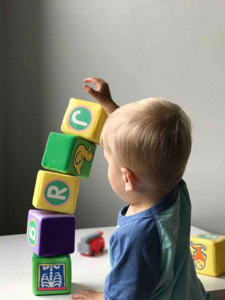 Child playing with building blocks - Photography credit: Ryan Fields