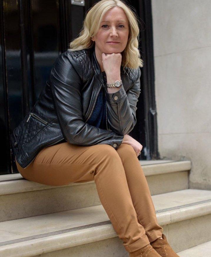 Jenny Holden sat on some steps