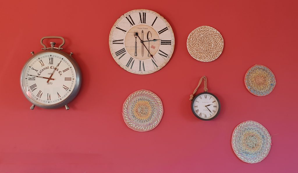 Clocks on a wall. Photography credit: Karim Manjra