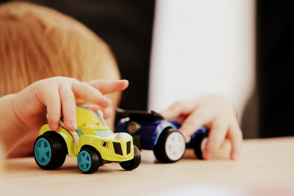 A child playing with cars. Photography credit: Sandy Millar