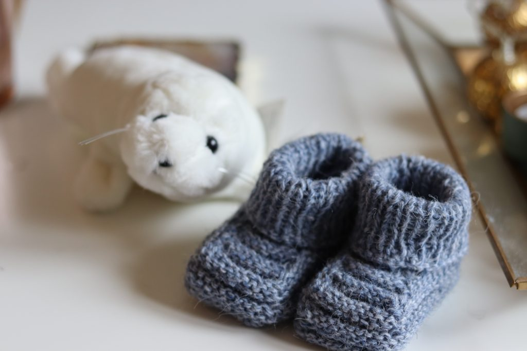 Blue knitted baby booties. Photography credit: Elsa Lilja